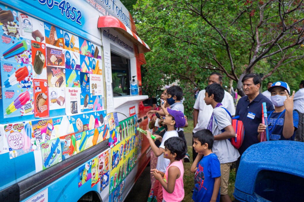 Getting ice cream from the ice cream truck at the party!
